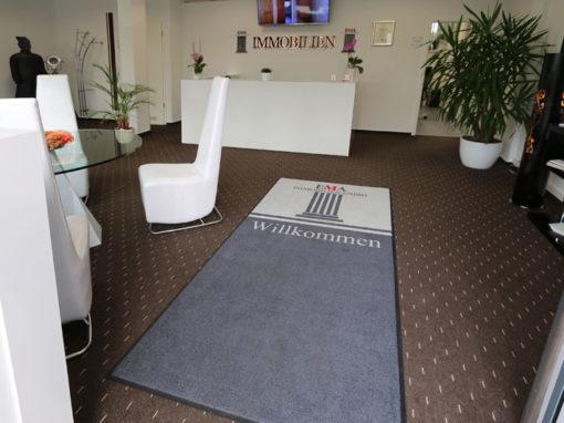 Fußmatte mit Logo für EM Immobilien
